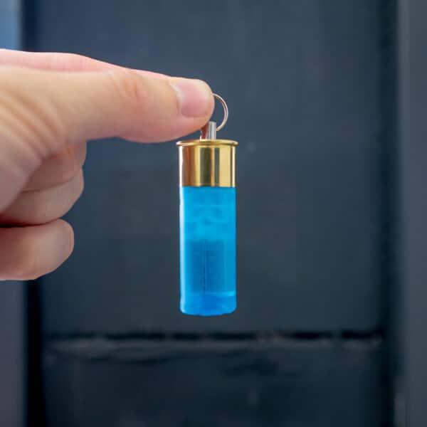 Schluesselanhaenger-12-70-Schrotpatrone-Blau-Transparent-Shop
